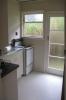 Die Küche - mit Tür hinters Haus zur Waschküche, Wäscheleine, zum Kräutergarten (der fehlt noch...)