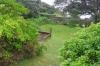 Blick von der Veranda in den Garten, auf's Meer